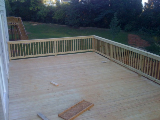 Pressure treated deck with handrail