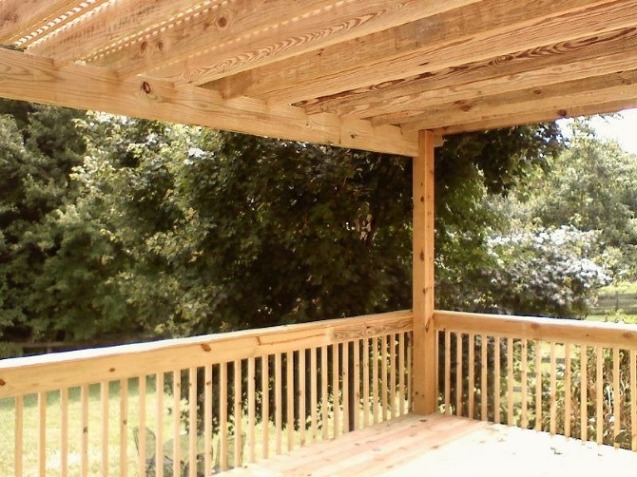Deck covered by a pergola topped with lattice