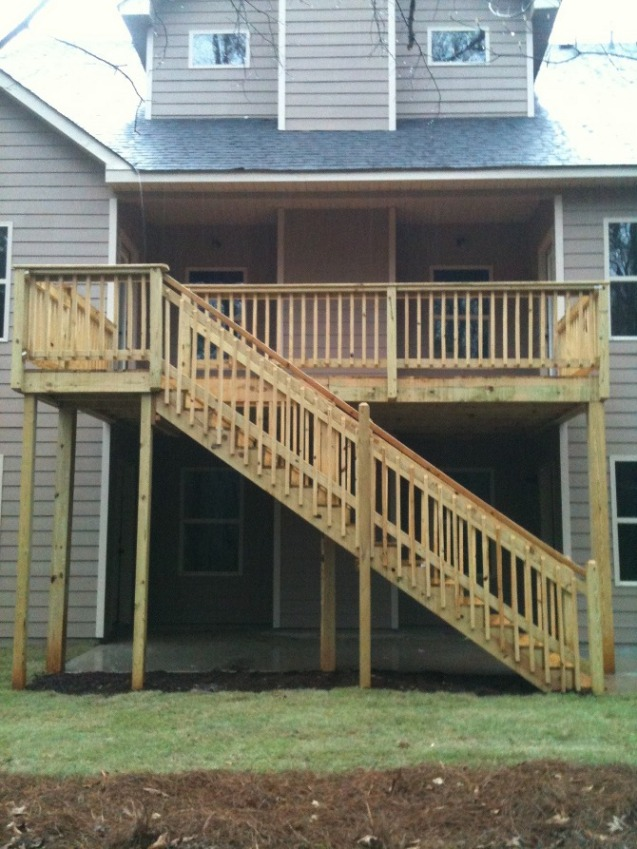 deck with handrail and stairs