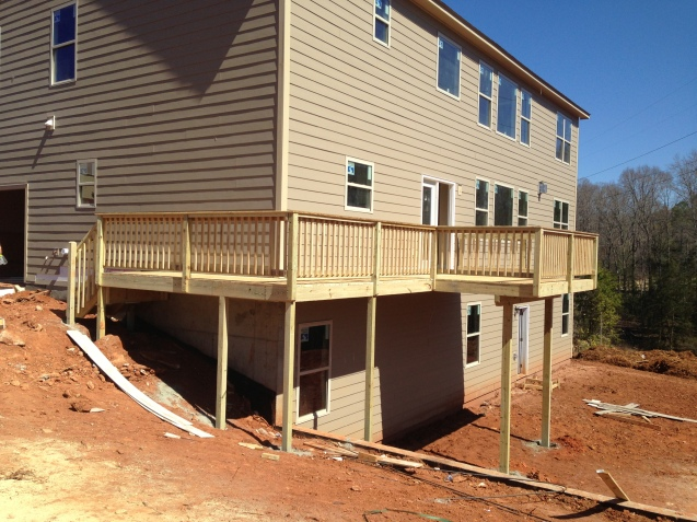 10x12 wood deck with handrail and wrap around walkway