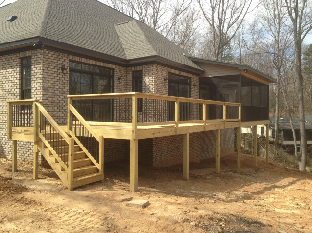 Deck with screened porch, bead board ceilings, and aluminum pickets.
